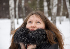 Brunette woman in snow winter park Stock Image