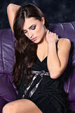 Brunette woman on sofa Royalty Free Stock Image
