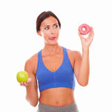 Brunette woman in sport clothing dieting Stock Image