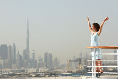 Brunette woman standing on cruise liner deck Stock Photo
