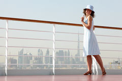 Brunette woman standing on cruise liner deck Stock Photography
