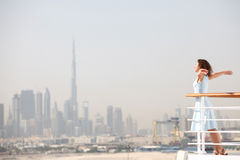 Brunette woman standing on cruise liner deck Royalty Free Stock Photos