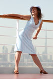 Brunette woman standing on cruise liner deck Stock Photos