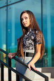 Brunette woman standing on stairway Royalty Free Stock Photo