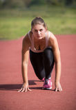Brunette woman standing on start line and ready to run Royalty Free Stock Photos