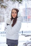 Brunette woman standing in winter park Stock Photography