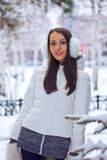Brunette woman standing in winter park Stock Images