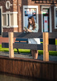 Brunette woman standing on wooden bridge with tablet Royalty Free Stock Photography