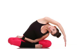 Brunette woman stretching muscles arms isolated Stock Images