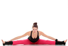 Brunette woman stretching muscles arms isolated Stock Photo
