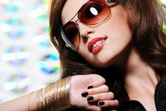 Brunette woman in stylish sunglasses Stock Photos