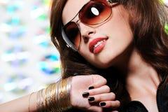 Brunette woman in stylish sunglasses. Portrait of modern and glamour brunette woman in the stylish black sunglasses Stock Photos