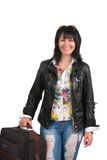 Brunette woman with a suitcase Royalty Free Stock Images
