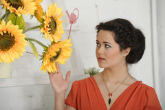 Brunette woman with sunflowers stock photography