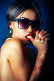 Brunette woman with  sunglasses. Fashion portrait of a beautiful brunette woman with  sunglasses Stock Images