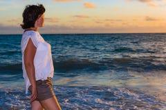 Brunette woman at sunrise Royalty Free Stock Image
