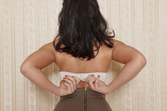 Brunette woman take off bra Royalty Free Stock Images