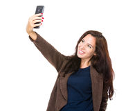 Brunette woman take selfie with smart phone Stock Photos