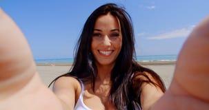 Brunette Woman Taking Self Portrait on Beach stock video footage