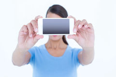 Brunette woman taking a selfie with her smartphone Royalty Free Stock Photo