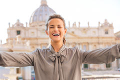 A brunette woman is taking a selfie and laughing Royalty Free Stock Images