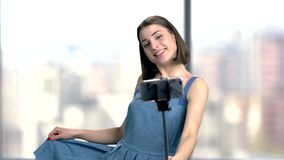 Brunette woman taking a selfie with monopod. stock video