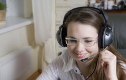 Brunette woman talking by headphone Stock Photography