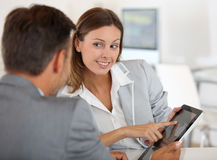 Brunette woman talking with investor Stock Photography