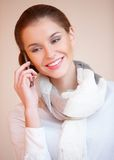 Brunette woman talking mobile phone Royalty Free Stock Photos