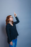 Brunette woman thirty years shows thumb up on Royalty Free Stock Photography