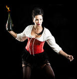 Brunette woman  throwing Molotov cocktail Stock Photography