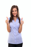 Brunette woman with thumbs up Stock Images