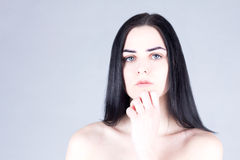 Brunette woman touching her chin by hand. Beauty concept Stock Images