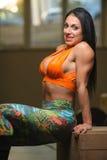 Brunette woman trainingat the gym Stock Photo