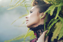 Brunette woman in the tropical forest Stock Photo