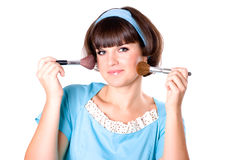 Brunette woman with two make-up brushes Royalty Free Stock Photography