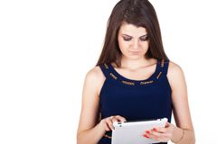 Brunette woman typing on her touch pad isolated Royalty Free Stock Image