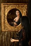 Brunette woman undressing in front the mirror Royalty Free Stock Images