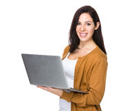 Brunette Woman use of notebook computer. Isolated on white background Royalty Free Stock Image