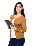Brunette woman use of the tablet pc. Isolated on white background Stock Images