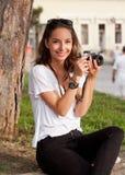Brunette woman using analog camera. Stock Photos