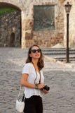 Brunette woman using analog camera. Stock Images