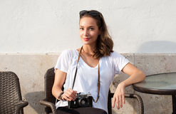 Brunette woman using analog camera. Royalty Free Stock Photography