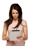 Brunette woman using a computer tablet Royalty Free Stock Image