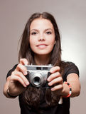 Brunette woman with vintage camera. Stock Images