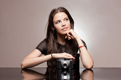 Brunette woman with vintage camera. Stock Image