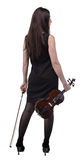 Brunette woman with violin from back Royalty Free Stock Photo
