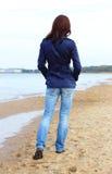 Brunette woman walking on the beach Stock Photos
