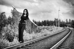 Brunette woman walking on the railroad Royalty Free Stock Photos