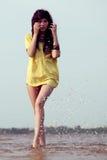 Brunette woman walking on water Royalty Free Stock Photo